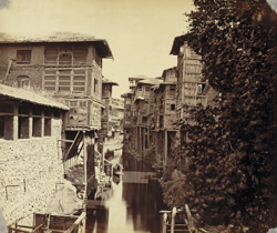 View of houses by the canal at Srinagar.